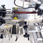 Ninon Down, CDA's automatic bottle labelling machine
