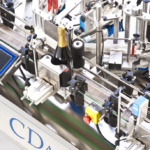 R1000 Foils, CDA's automatic champagne bottle labelling machine